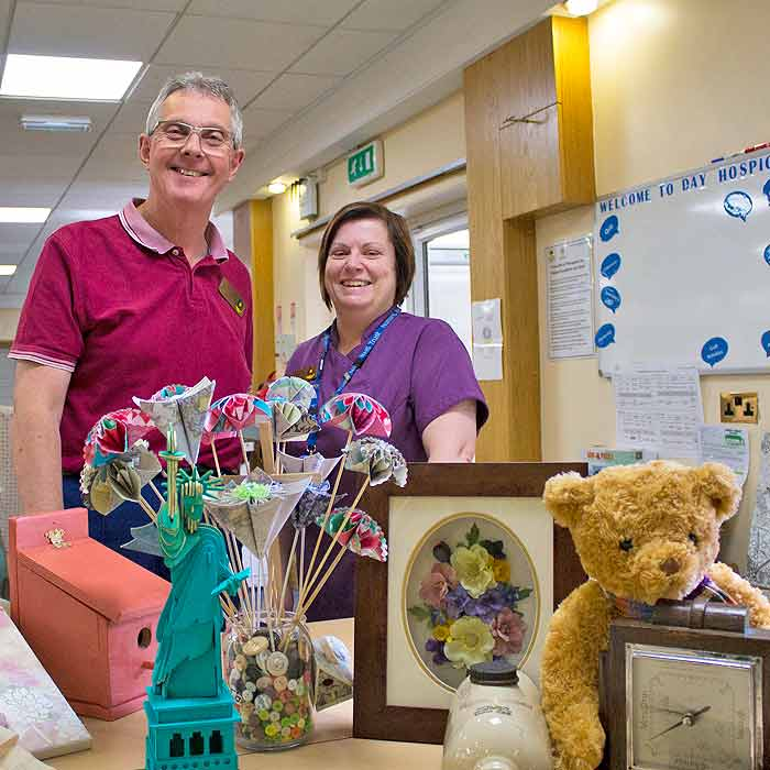 Vlounteers at the hospice with craft items